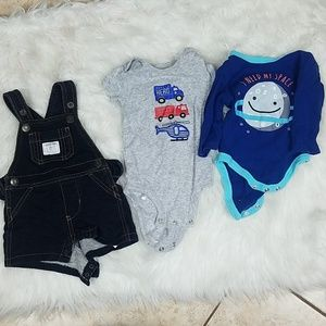 A bundle of 2 baby onesies and a pair of overalls
